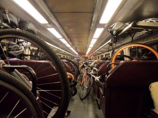 Cyclists took the commuter rail from South Station last year to reach the Boston Marathon's starting line in Hopkinton for the Midnight Marathon bike ride.