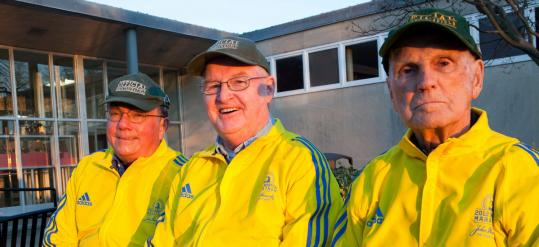 Kevin O'Malley, David J. Ryan, and John Connelly (left to right) in their BAA finish-line jackets.