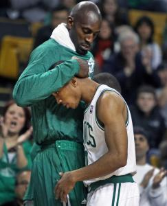 Kevin Garnett congratulates guard Avery Bradley on his inspired play.