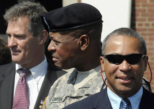 Brigadier General Joseph C. Carter has been placed on administrative leave by Governor Deval Patrick (right) pending a rape investigation. At left, Senator Scott Brown.