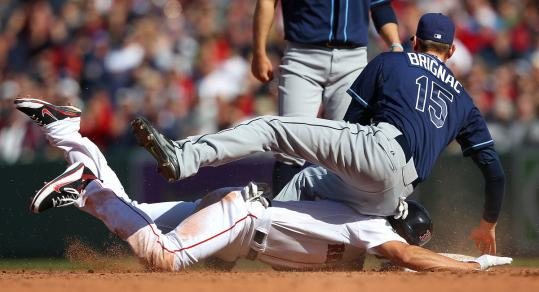 The Rays' Reid Brignac comes down hard on Jacoby Ellsbury's right shoulder on a play at second, knocking him from the game - and possibly much longer.