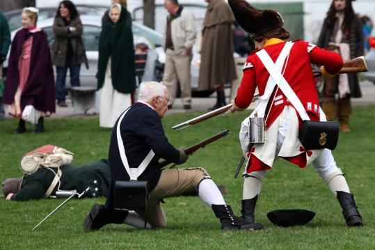 The bayonet slipped off on the third practice run as Minuteman Jim Hart worked with Mike Foley, in the role of the British soldier, to get it right for Patriots Day. Hart, 77, has played Jonas Parker for more than 20 years.
