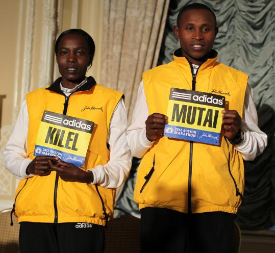 The 2011 champions - Caroline Kilel and Geoffrey Mutai - received their bibs Saturday morning.