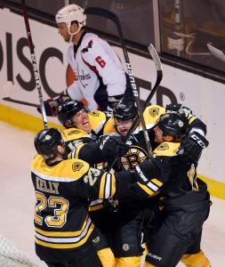 The Bruins get together to celebrate Benoit Pouliot's tying goal in the third period.