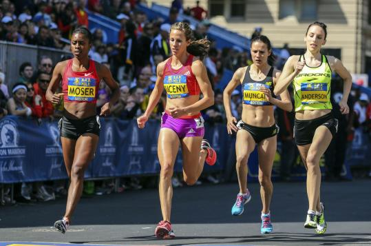 In the women's invitational mile held along the Marathon route on Boylston Street, (left to right) Traniere Moser, Morgan Uceny, Marina Muncan, and Gabriele Anderson battle for position. Uceny finished first in a time of 4:43.8, and defending champion Muncan placed second in 4:44.5.