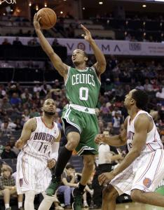 Celtics guard Avery Bradley (22 points) drives between Bobcats defenders D.J. Augustin (left) and Gerald Henderson.