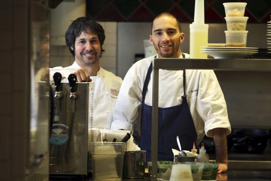 Ken Oringer with chef de cuisine Douglas Rodrigues. After renovations, the dining room (left) was modernized. Cassolette, on the tasting menu, is one of Oringer's signature dishes.