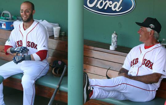 With all that was going on, manager Bobby Valentine and Dustin Pedroia share a laugh in the dugout before the game.
