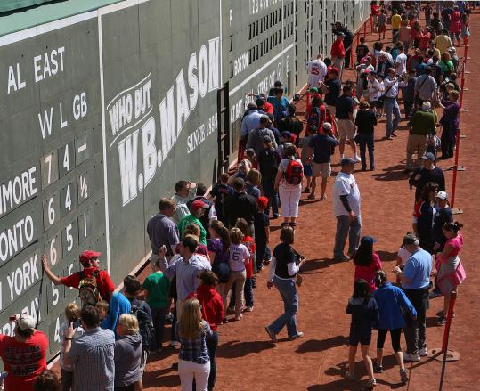 Fans got a hands-on experience at Fenway's famed left-field Green Monster during an open house on Thursday.