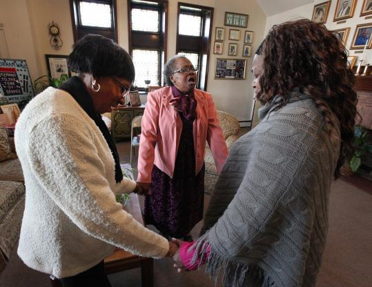 Betty Williams (top left), the Rev. Gracie Redfearn, and Barbara Ravenell prayed at Charles Street AME Church. Work on the church's Renaissance Center was halted amid financial woes. The Rev. Gregory Groover had big dreams for the congregation.
