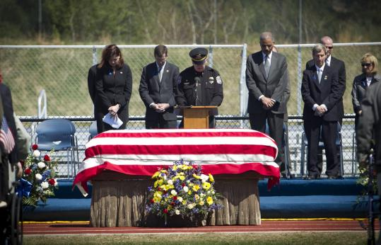 The funeral service for Greenland, N.H., Police Chief Michael Maloney drew thousands of mourners and law enforcement officials Thursday.