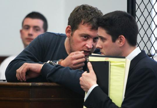 Timothy Kostka, 26, spoke to attorney Bradford R. Stanton during his arraignment in South Boston Municipal Court Monday in the April 16 stabbing death of Barbara Coyne. He was ordered held without bail on the homicide charge.