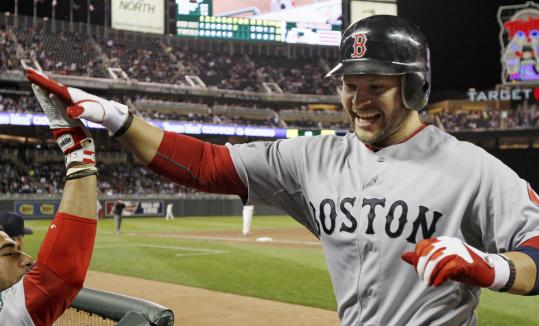 The Red Sox had to hand it to Cody Ross after the first of his two home runs tied it in the seventh. His homer in the ninth won it.