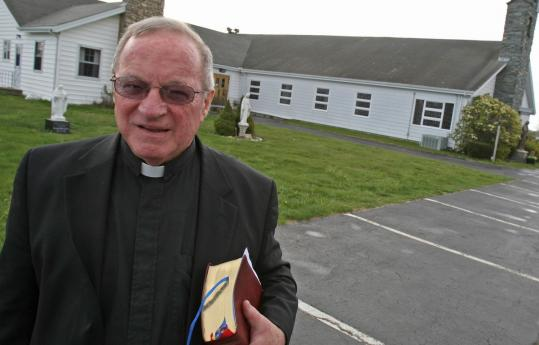 The Rev. Richard Crowley serves Sacred Heart Church in Middleborough and also celebrates Mass at St. Rose of Lima Church in Rochester (rear).