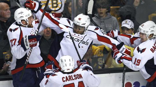 An overtime goal by Washington Capital Joel Ward (center) knocked the Bruins out of the NHL playoffs Wednesday night.