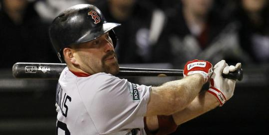 Kevin Youkilis follows through on a grand slam in the third inning of the Red Sox' win.