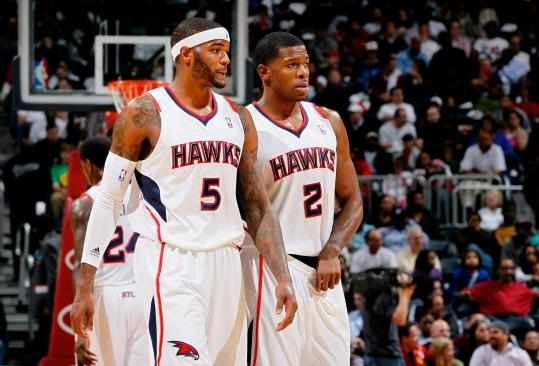 The Celtics know they have to keep an eye on the Hawks' Josh Smith (5) and Joe Johnson during their playoff series.