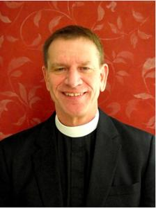 The Rev. William W. Rich is one of three nominees on the May 19 ballot.
