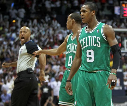 Lack of discipline by Rajon Rondo (right) during his confrontation with referee Marc Davis (left) late in Game 1 has put the Celtics in a difficult position against the Hawks.