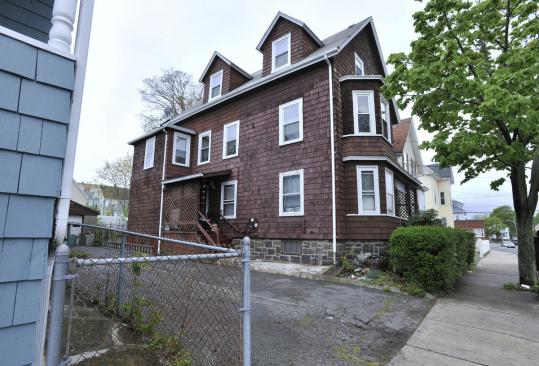 Donna Breau and her mother, Melba Trahant, lived on the second floor of this Sheridan Street house in Lynn.