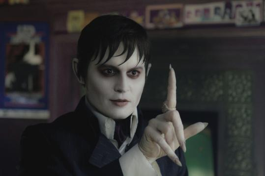 "Johnny Depp portrays Barnabas Collins in Tim Burton's comedic reimagining of ""Dark Shadows."""