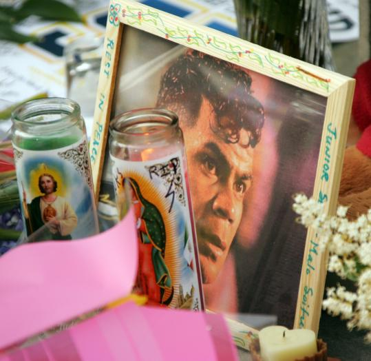 Junior Seau is remembered with a memorial outside his restaurant in San Diego.