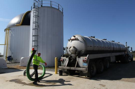 Joe Bouchard prepared to offload food waste at the Jordan Dairy Farm in Rutland, now the only site in the state where such waste is converted into energy.