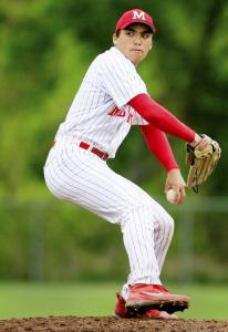 Jarrod Casey makes a pitch against North Middlesex. Milford is switching to the Hockomock League next year. switched leages this season.