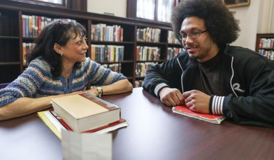 Francisco Paulino, 23, spends Saturday mornings writing, praying, and talking with Andrea Bliss-Lerman, an evangelical Christian spiritual director, at the Lynn Public Library.
