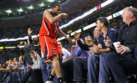 Tracy McGrady sampled beer spilled on him by fans after a dive into the seats for a loose ball.
