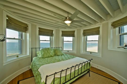 Ocean views abound in the master bedroom (left) of the house at 139 Wingaersheek Road, Gloucester, which also has its own beach.