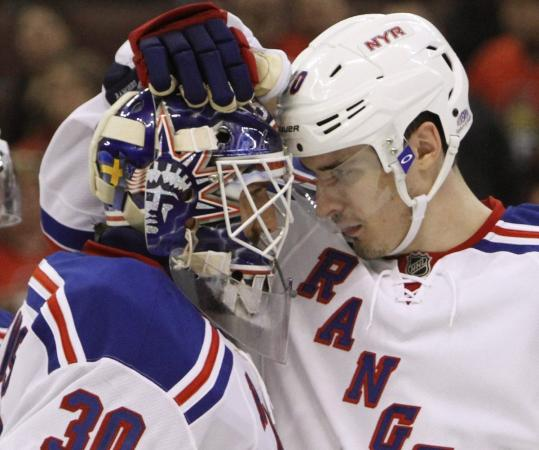 Chris Kreider (right) celebrates with goaltender Henrik Lundquist after the Rangers beat the Senators in a first-round playoff game.