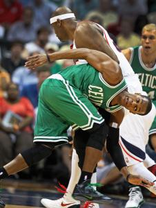 Celtics guard Rajon Rondo tried, but he couldn't cut down Hawks center Erick Dampier in the first quarter.