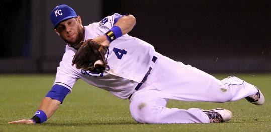 Royals left fielder Alex Gordon prevented a run with a sliding catch in the ninth inning.