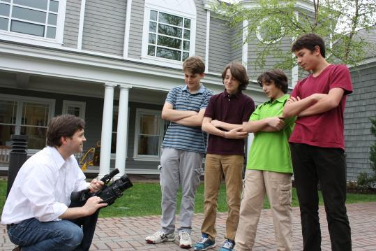 Mike Scafati, a teacher at the Meadowbrook School in Weston, gathered students (from left) Andrew Gord, Ryan O'Toole, Owen Dostie, and Damian Liu to commemorate their entry in last year's Boston 48 Hour Film Project.