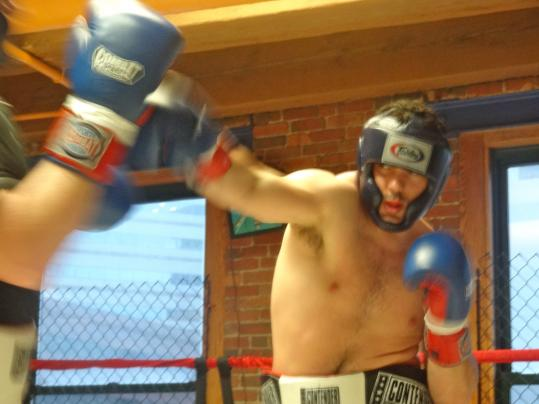 "Nick Rossi of Walpole, a novice pugilist in training for the second annual Haymakers for Hope Thursday, calls boxing ""definitely the best workout ever."""