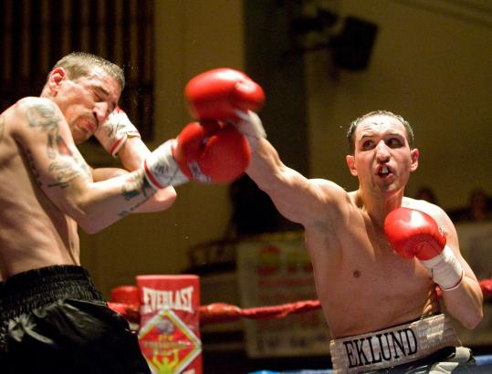 Sean Eklund (right) of Lowell fought James Ventry on Wednesday in the first pro boxing event at Memorial Auditorium in seven years.