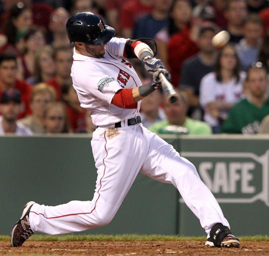 Dustin Pedroia hammers an RBI double to left in the third inning. He has a 13-game hit streak.