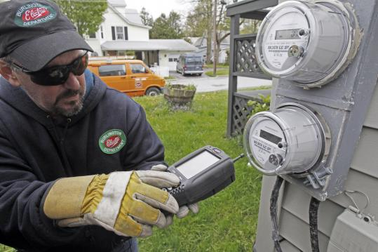 "Mark Delbeck of Burlington Electric checked the radio frequency of a new ""smart meter.''"
