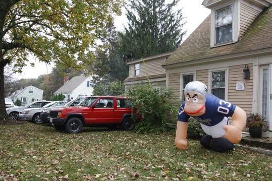 Fans attending a Patriots game parked in the front yard of a North Street residence in October 2009. Foxborough's Town Meeting voted to put an end to the practice Monday. Fans attending a Patriots game parked in the yard of a North Street residence in 2009. Foxborough's Town Meeting voted to put an end to the practice Monday.