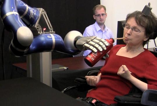 By picturing her own arm and hand moving, Cathy Hutchinson controlled a robot.