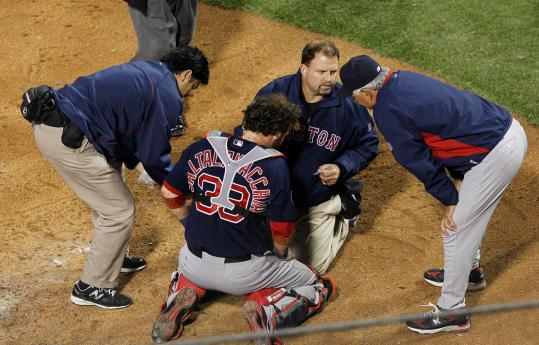 Jarrod Saltalamacchia receives medical attention after having his left ear lacerated by a ball i