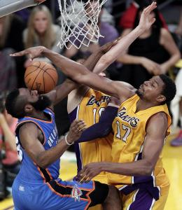 James Harden has his shot blocked by LA's Andrew Bynum (right) and Pau Gasol, but the Thunder rallied to take a 3-1 series lead.
