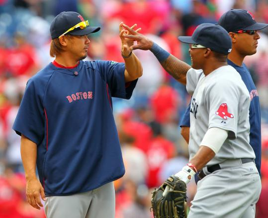 Daisuke Matsuzaka (left) congratulates Marlon Byrd after the Red Sox registered the final out in a 5-1 win over the Phillies.
