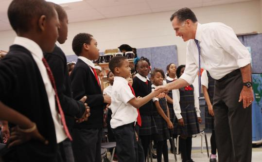Mitt Romney greeted students in a music class at Universal Bluford Charter School in West Philadelphia on Thursday.