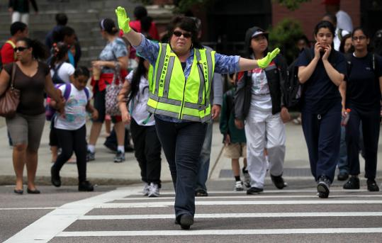 Crossing guard Sharon Walsh helped students from the William E. Russell School get across Columbia Road safely.