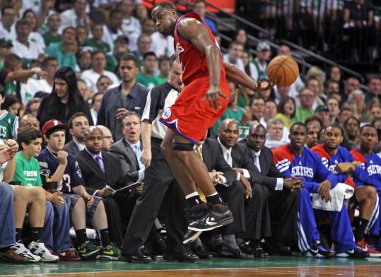Elton Brand makes a leaping save of a loose ball but his backhanded flip went out of bounds.