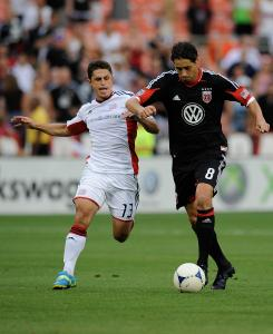 D.C. United's Branko Boskovic (right) battles with New England's Ryan Guy in the first half.