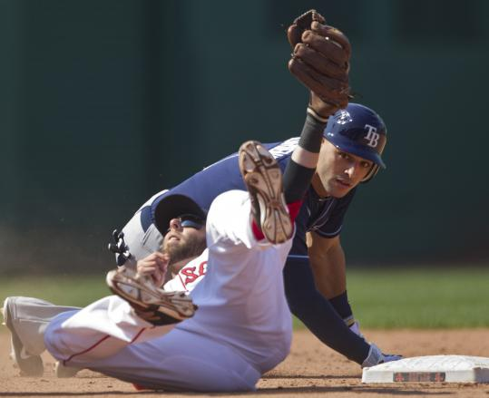 Dustin Pedroia holds up the ball as he waits for the call; Tampa Bay&#8217;s Sean Rodriguez is safe on a double in the seventh inning.