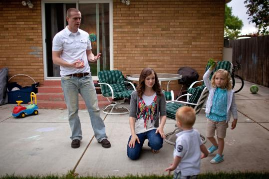 Bryan and Jenny Hamblin played with their daughter Lily, 4, and son Tennyson, 1, at their home in Ogden, Utah.